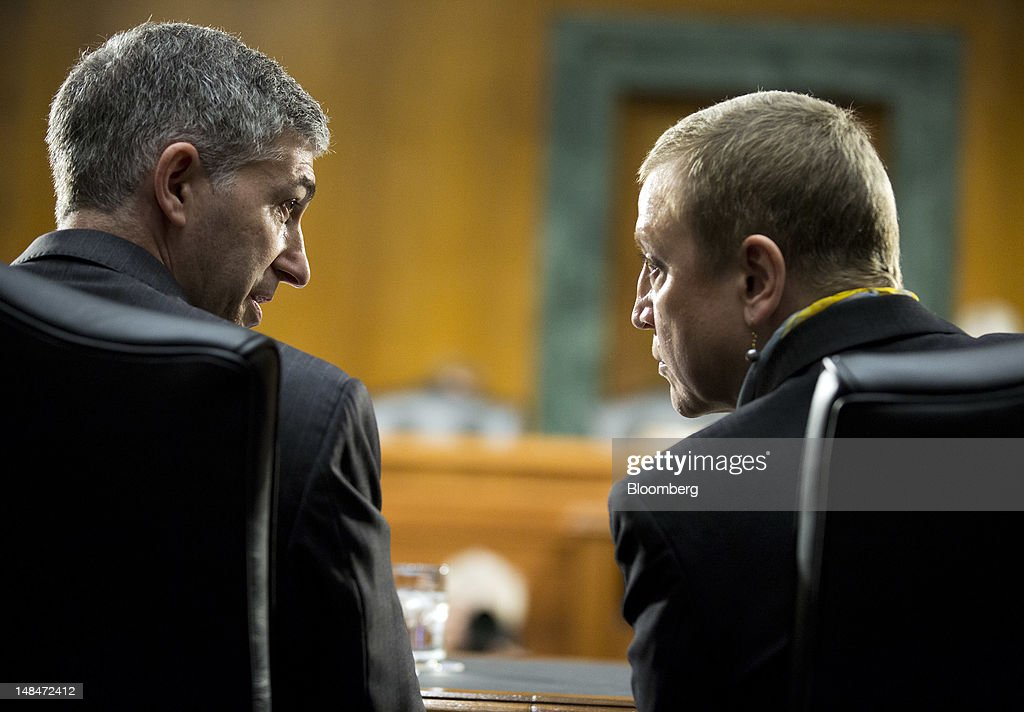 Stuart Levey, chief legal officer for HSBC Holdings Plc, left, confers with Irene Dorner, president and chief executive officer of HSBC North America Holdings Inc., before the start of a hearing of the U.S. Senate Homeland Security and Governmental Affairs Committee's Permanent Subcommittee on Investigations in Washington, D.C., U.S., on Tuesday, July 17, 2012. HSBC Holdings Plc's head of group compliance, David Bagley, told the Senate panel he will step down amid charges the bank gave terrorists, drug cartels and criminals access to the U.S. financial system by failing to guard against money laundering. Photographer: Joshua Roberts/Bloomberg via Getty Images