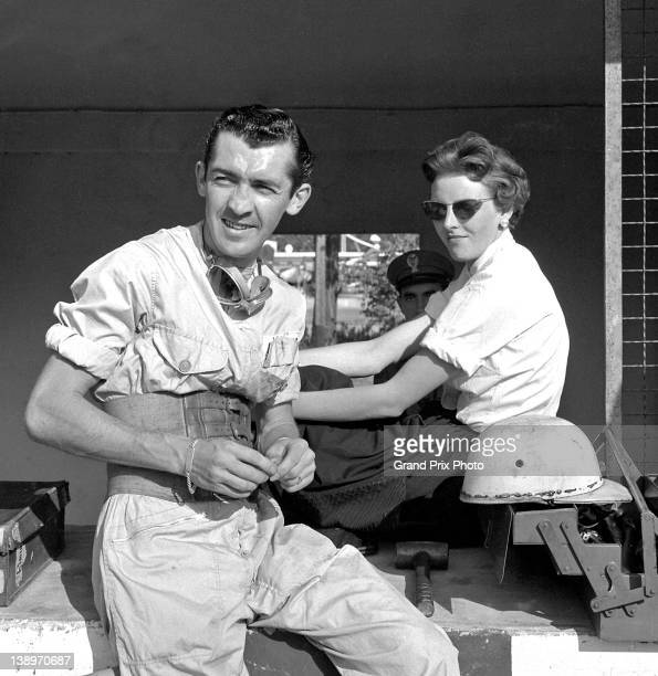 Stuart LewisEvans of Great Britain driver of the Vandervell Products Ltd Vanwall Straight4 in the pits with a friend during practice for the Italian...