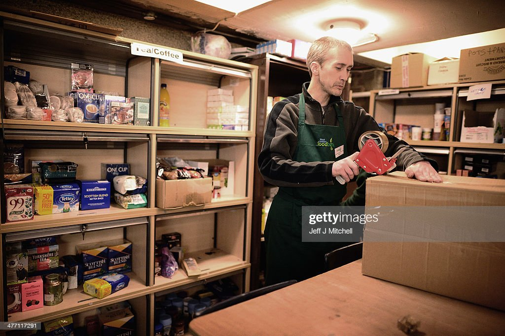 A Stuart Little volunteer packs food at a food bank on March 7, 2014 in Whitburn, Scotland. Charities based in Scotland are reporting that many families are living in poverty having to turn to food banks, and are struggling to heat their homes and clothe their children and themselves. The Trussell trust runs a network of foodbanks throughout the UK, giving emergency food to people in crisis. In the past year demand has risen in Scotland and the rest of the UK.
