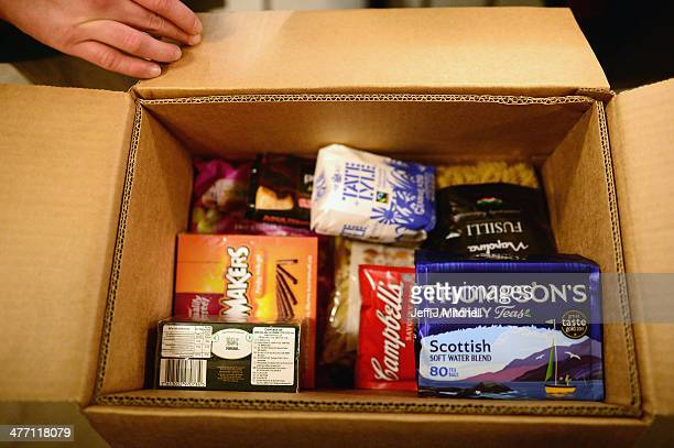 Stuart Little volunteer packs food into a box at a food bank on March 7 2014 in Whitburn Scotland Charities based in Scotland are reporting that many...