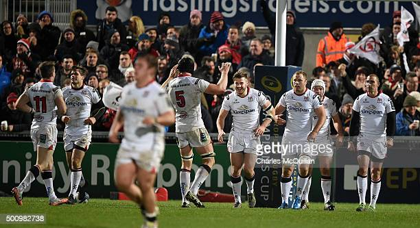 Stuart McCloskey of Ulster celebrates with team mates after scoring a try during the European Champions Cup Pool 1 rugby game between Ulster and...