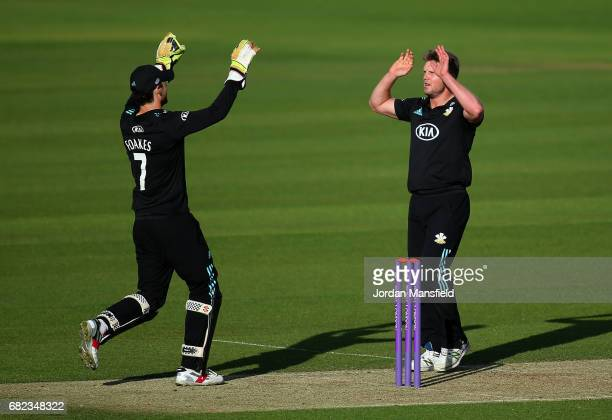 Stuart Meaker and Ben Foakes of Surrey celebrate dismissing Matt Coles of Kent during the Royal London OneDay Cup match between Surrey and Kent at...