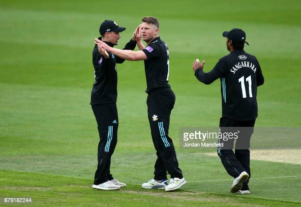 Stuart Meaker of Surrey celebrates with him teammates after dimissing Adam Voges of Middlesex during the Royal London OneDay Cup match between Surrey...