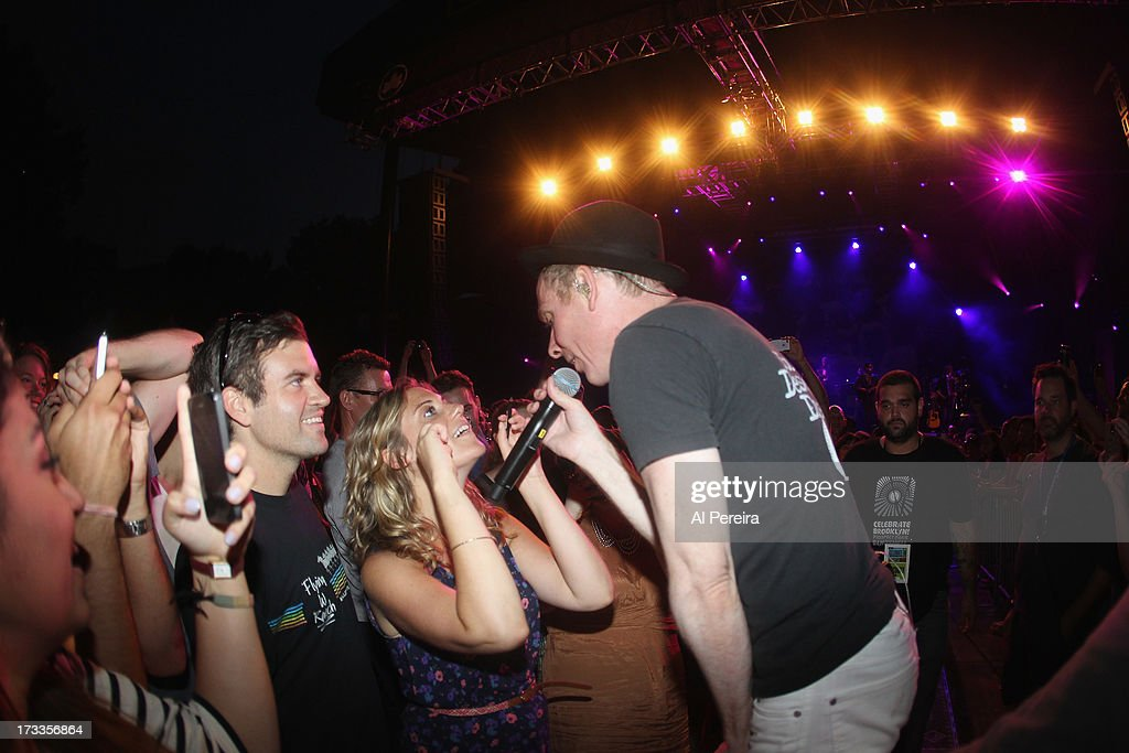 Stuart Murdoch of Belle And Sebastianhas mascara applied by a fan when Belle And Sebastian performs a concert to benefit Celebrate Brooklyn! at Prospect Park Bandshell on July 11, 2013 in the Brooklyn borough New York City.