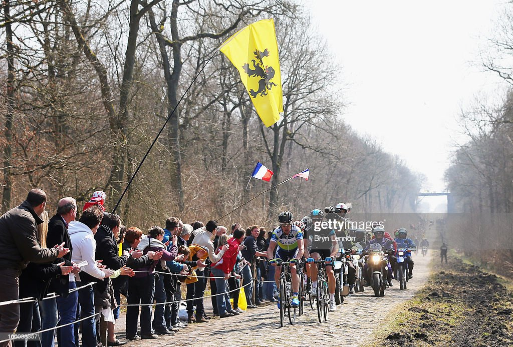 Stuart O'Grady of Australia and Orica Greenedge and Mathew Hayman of Australia and SKY Procycling leads the peloton through the Arenberg Forest during the 2013 Paris - Roubaix race from Compiegne to Roubaix on April 7, 2013 in Roubaix, France. The 111th Paris - Roubaix race is 254km long and contains 27 sections of cobblestones.