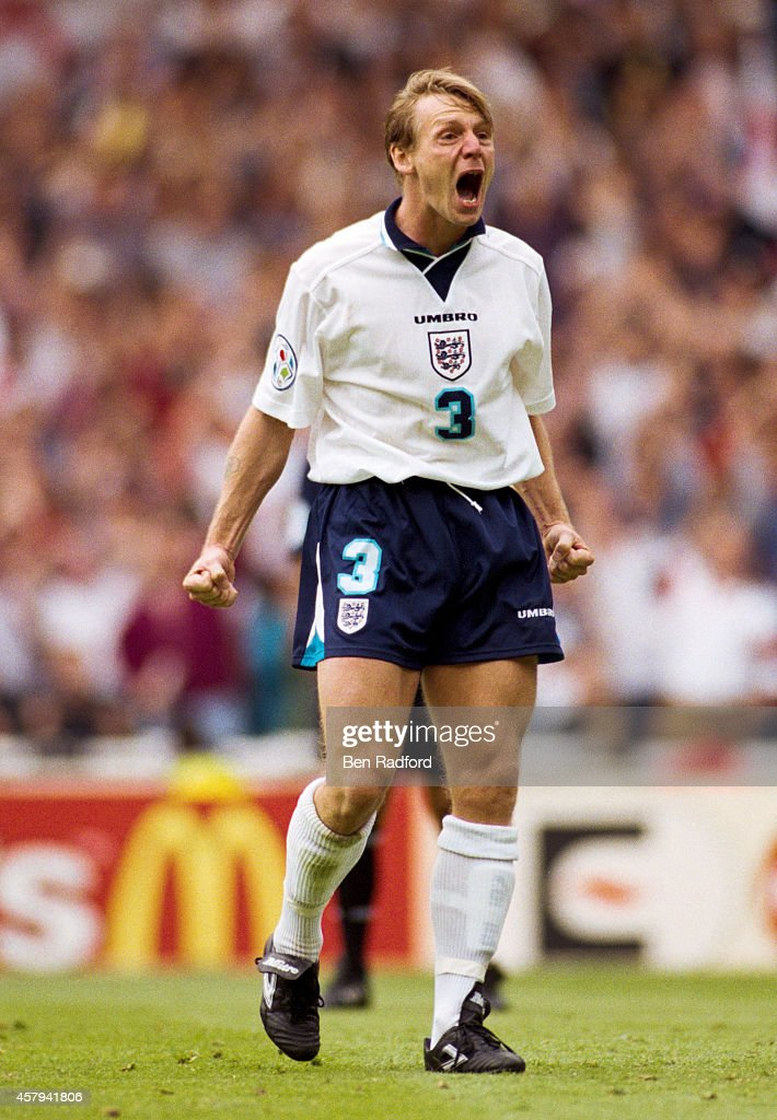 Stuart Pearce of England celebrates after scoring his penalty during the 1996 European soccer championship match between England and Spain at Wembley...