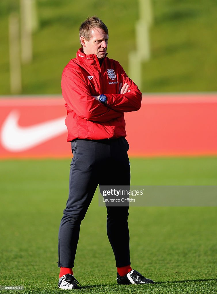 <a gi-track='captionPersonalityLinkClicked' href=/galleries/search?phrase=Stuart+Pearce&family=editorial&specificpeople=213348 ng-click='$event.stopPropagation()'>Stuart Pearce</a> of England share looks on during a training session at St Georges Park on February 4, 2013 in Burton-upon-Trent, England.