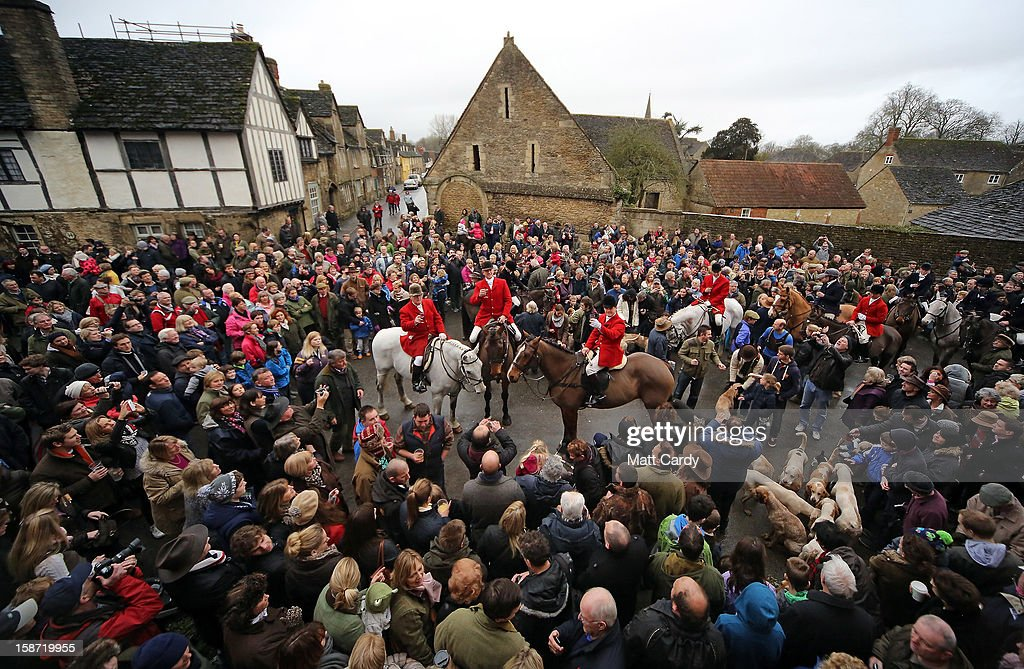 Stuart Radbourne, (centre foreground) huntsman and joint-master with the Avon Vale Hunt, toasts supporters who have gathered for their traditional Boxing Day hunt, on December 26, 2012 in Lacock, England. As hundreds of hunts met today, Environment Secretary Owen Paterson claimed that moves to repeal the ban on hunting with dogs in England and Wales may not happen in 2013, although he insisted it was still the government's intention to give MPs a free vote on lifting the ban.