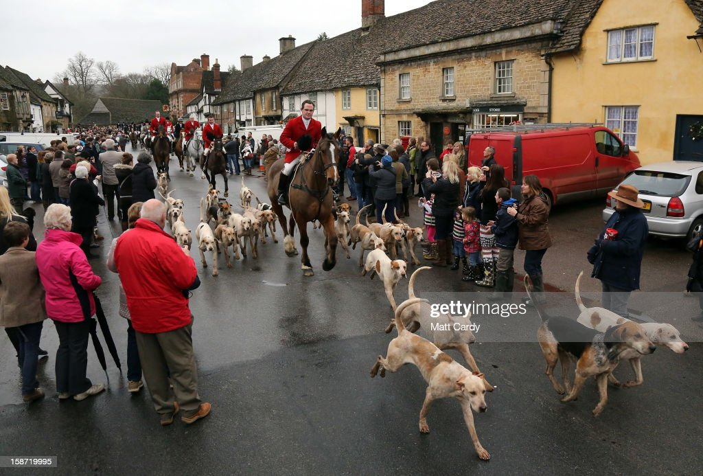 Stuart Radbourne, huntsman and joint-master with the Avon Vale Hunt, leads the riders and hounds for their traditional Boxing Day hunt, on December 26, 2012 in Lacock, England. As hundreds of hunts met today, Environment Secretary Owen Paterson claimed that moves to repeal the ban on hunting with dogs in England and Wales may not happen in 2013, although he insisted it was still the government's intention to give MPs a free vote on lifting the ban.