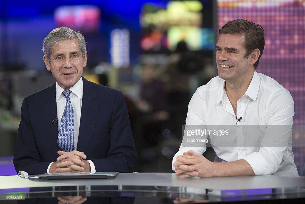 Stuart Rose, chairman of the Duvet & Pillow Warehouse Ltd., left, and Charles 'Charlie' Hunt, chief executive officer of the Duvet & Pillow Warehouse Ltd., react during a Bloomberg Television interview in London, U.K., on Wednesday, 20, 2013. U.K. government figures show economic growth accelerated to 0.8 percent in the third quarter, the housing market is strengthening and about 60,000 jobs are being created every month, boosting taxes from company profits, payrolls, property purchases and sales. Photographer: Simon Dawson/Bloomberg via Getty Images