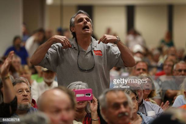 Stuart Smith speaks as he disagrees with Rep Brian Mast during a town hall meeting at the Havert L Fenn Center on February 24 2017 in Fort Pierce...