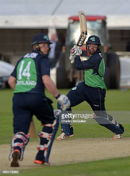 Stuart Thompson of Ireland breaks his bat whilst striking a ball during the ODI cricket game between Ireland and Australia at Stormont cricket ground...