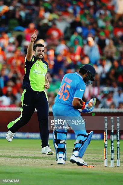 Stuart Thompson of Ireland celebrates after bowling Rohit Sharma of India out during the 2015 ICC Cricket World Cup match between Ireland and India...