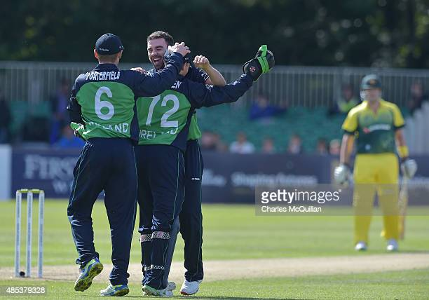 Stuart Thompson of Ireland celebrates after taking the wicket of Australian captain Steve Smith during the ODI cricket game between Ireland and...