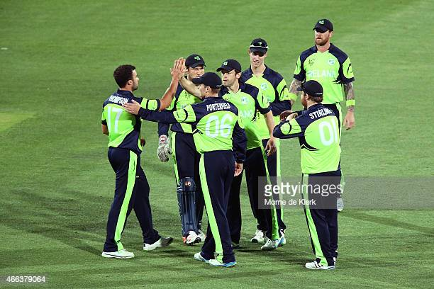 Stuart Thompson of Ireland is congratulated by teammates after he got the wicket of Ahmad Shahzad of Pakistan during the 2015 ICC Cricket World Cup...