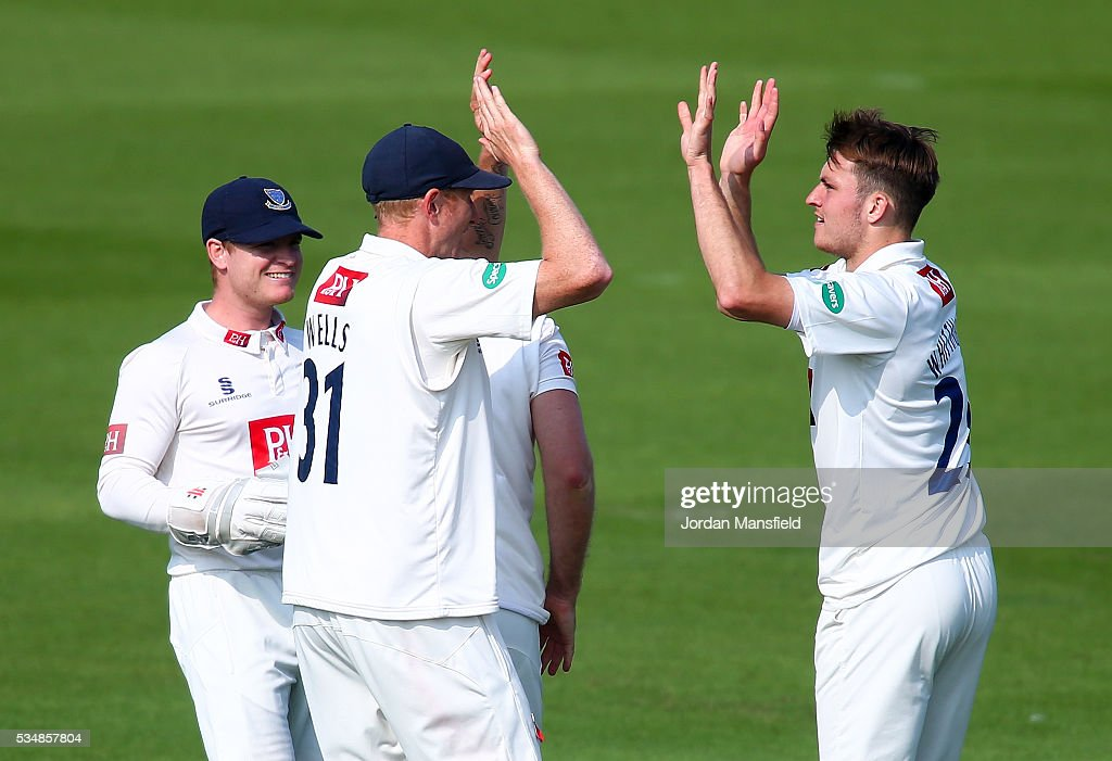 Stuart Whittingham celebrates with his teammates after getting the wicket of Wayne Madsen of Derbyshire during day one of the Specsavers County Championship Division Two match between Sussex and Derbyshire at The 1st Central County Ground on May 28, 2016 in Hove, England.