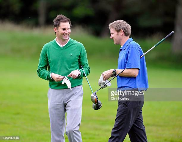 Stuart Wilson and David Dickson of Eastwood Golf Club chat on the twelth tee during the Virgin Atlantic PGA National ProAm Championship Regional...
