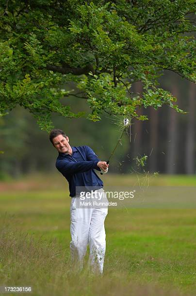 Stuart Wilson of Eastwood Golf Club plays his approach to the 18th during The Lombard Trophy Regional Qualifier at Ladybank Golf Club on July 10 2013...