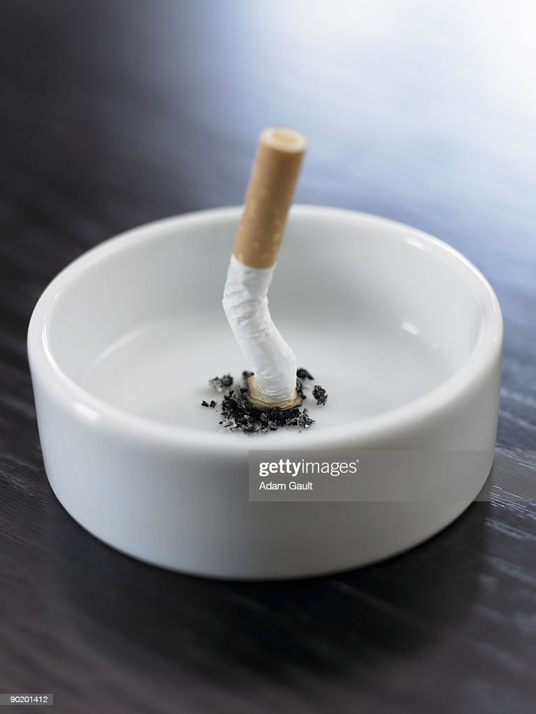 Stubbed out cigarette in ashtray