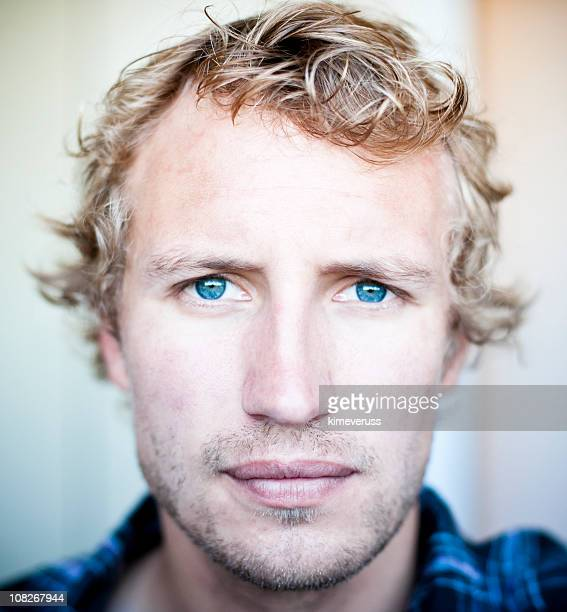 Stubble two days growth blonde hair and blue eyes