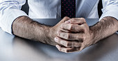 stubborn businessman hands and fists held firmly showing restrained anger, stress or aggressiveness for fighting body language in corporate business