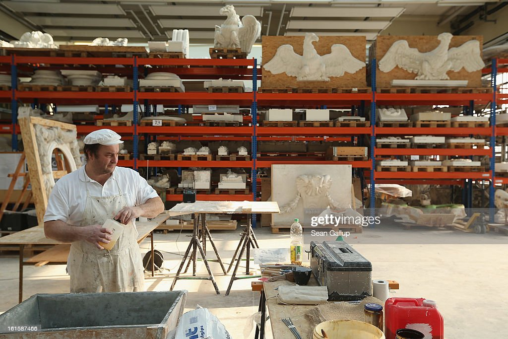 Stucco master Christian Ortlepp prepares a plaster mixture during the preparation of a silicon mould at the Schlossbauhuette studio where a team of sculptors is creating decorative elements for the facade of the Berliner Schloss city palace on February 12, 2013 in Berlin, Germany. The Berliner Schloss was the residence of the Prussian Kaiser and was among the major architectural landmarks of Berlin until it was heavily damaged by Allied bombing in 1945. The communist authorities of East Berlin demolished the building in the 1950s, and today's Berlin government is pursuing an ambitious project to rebuild the palace according to a design by Italian architect Franco Stella, which will recreate the facade of the building but with a modern interior at a cost of approximately EUR 590 million. The Humboldt Forum, the foundation leading the project, has given the Schlossbauhuette sculptors the formidable task of recreating the hundreds of architectural elements that decorated the facade, and though some original pieces were saved, more often the sculptors have only old black and white photos as reference.