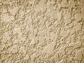 Stucco mortar plastered wall texture with grey and rough surface background.