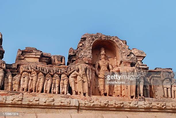 Stucco work and sculptures depicting scenes from Ramayana and other Spiritual Hindu Epics at the Hazara Rama Temple Hampi Karnataka India