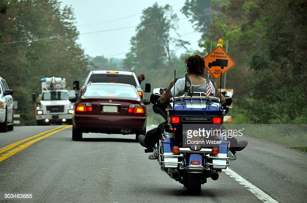 Stuck in traffic while riding a motorcycle Car in front has dog peeking out the passenger seat along Rout 29 North Stroudsburg Pennsylvania