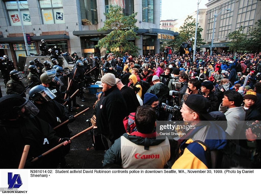 Student activist David Robinson confronts police in downtown Seattle WA November 30 1999