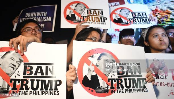 Student activists hold anti US President Donald Trump banners during a lightning rally before the start of the 31st Association of Southeast Asian...