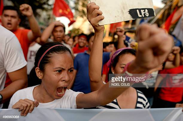 Student activists shout anti AsiaPacific Economic Cooperation slogans near the US embassy in Manila on November 13 2015 The group expressed their...