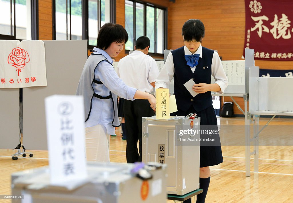 A student aged 18 casts her ballot at an early polling station set at Kashihara High School on June 27, 2016 in Kashihara, Nara, Japan. From the Upper House election, taking place on July 10, the age of voters lowers to 18.