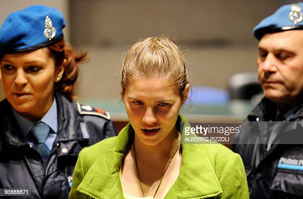 US student Amanda Knox accused of taking part in the killing of British student Meredith Kercher in 2007 looks on during a session of her trial on...