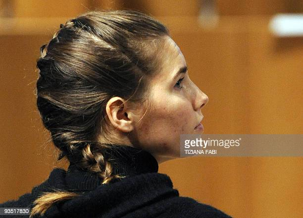 US student Amanda Knox accused of taking part in the killing of her British roommate Meredith Kercher arrives for a trial session on December 1 2009...