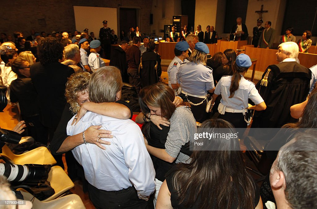 U.S. student Amanda Knox's relatives react as they listen to the verdict that overturns her conviction and acquits her of murdering her British roommate Meredith Kercher, at the Perugia court on October 3, 2011 in Perugia, Italy. American student Amanda Knox and her Italian ex-boyfriend Raffaele Sollecito have won their appeal against their conviction in 2009 of killing their British roommate Meredith Kercher in Perugia, Italy in 2007. The pair had served nearly four years in jail after initially being sentenced to 26 and 25 years respectively.