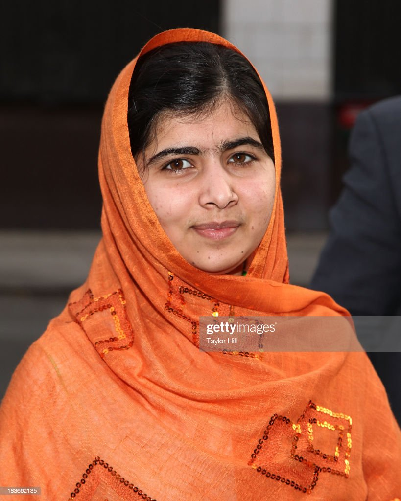 Student and blogger <a gi-track='captionPersonalityLinkClicked' href=/galleries/search?phrase=Malala+Yousafzai&family=editorial&specificpeople=5849423 ng-click='$event.stopPropagation()'>Malala Yousafzai</a> arrives to promote her book 'I am Malala' at 'The Daily Show' on October 8, 2013 in New York City. Malala was shot multiple times in an assassination attempt in Pakistan by the Taliban on October 9, 2012 while returning home from school.