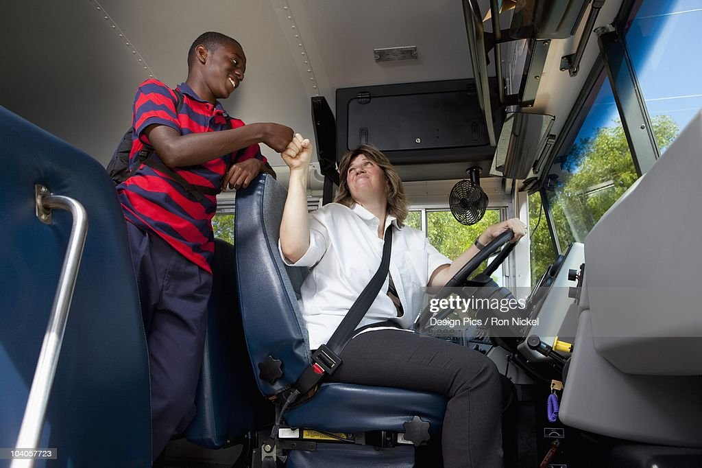 Student And School Bus Driver Greeting Each Other