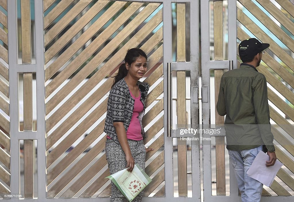 A student Anushka Kashyap from Agra, seen crying as she arrived few minutes late to the examination centre for 'National Eligibility Entrance Test' (NEET) exam for admissions to MBBS and BDS courses, at DPS School R K Puram, on May 1, 2016 in New Delhi, India. She was not allowed to enter the examination hall. The Supreme Court had on Saturday said that the entrance test for admission to MBBS and BDS courses for the academic year 2016-17 will be held as per the schedule through the two-phased common entrance test NEET on May 1 and July 24.