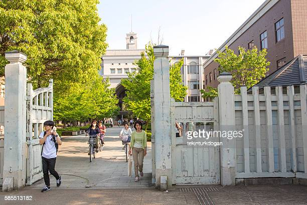 student are at entrance gate of kyoto-university in kyoto  japan