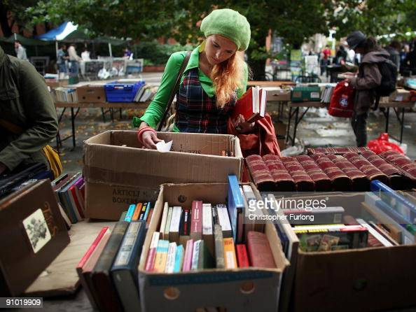 A student arriving for Manchester University's freshers week sifts through second hand books for sale on September 22 2009 in Manchester England As...