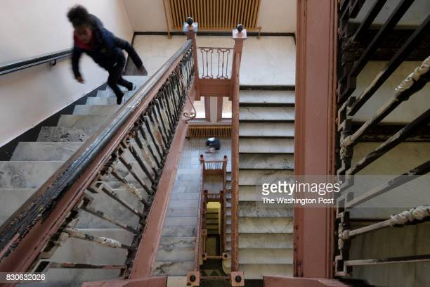 A student ascends a stairwell at Wilkinsburg High School in Wilkinsburg PA October 21 2015 Constructed in 1910 the school has steel staircases with...