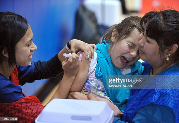 A student at Carlin Springs Elementary School receives an H1N1 flu vaccination January 7 2010 in Arlington Virginia The US Centers for Disease...