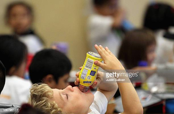 A student at Fairmount Elementary School drinks a bottle of Nesquik chocolate milk during lunch hour on November 12 2010 in San Francisco California...