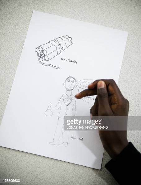 A student at Rinkeby's middle school shows his drawing of the inventor of dynamite Alfred Nobel during a class about the Nobel Prize on October 2...