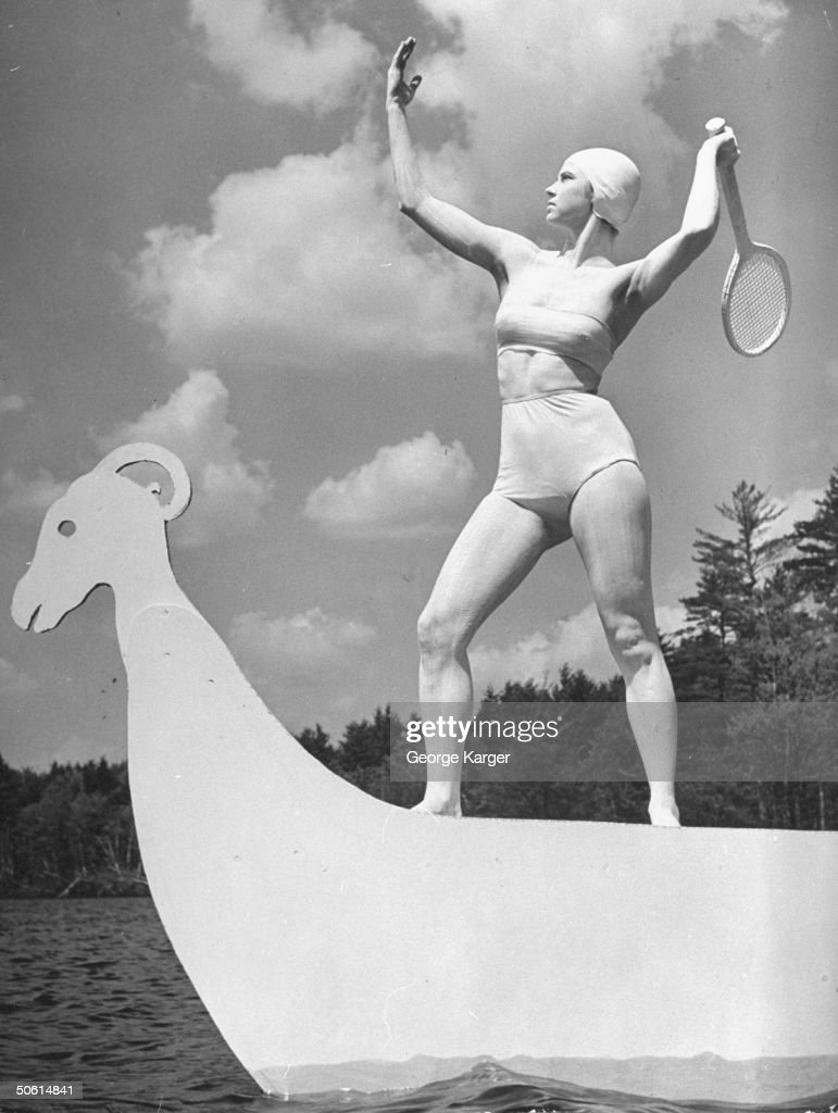 Student at Sargent College striking an athletic pose representing the game of tennis.