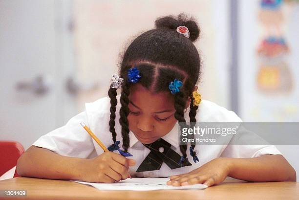 A student at Sisulu Children''s Adademy a Harlem charter school works on an assignment June 21 2000 in New York City Charter schools are independent...