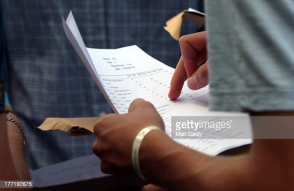 A student at the Ridings' Federation Winterbourne International Academy reviews the GCSE results on August 22 2013 in Bristol England As hundreds of...