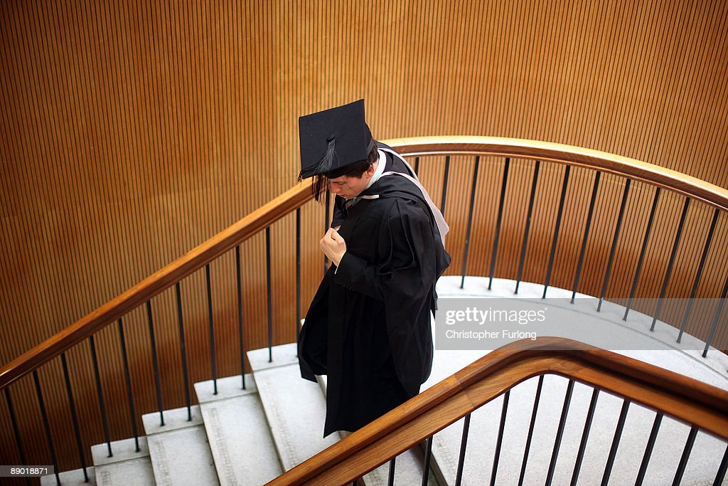 A student at the University of Birmingham walks down stairs during the University's degree congregations on July 14, 2009 in Birmingham, England. Over 5000 graduates will be donning their robes this week to collect their degrees from The University of Birmingham. A recent survey suggested that there are 48 graduates competing for every job.