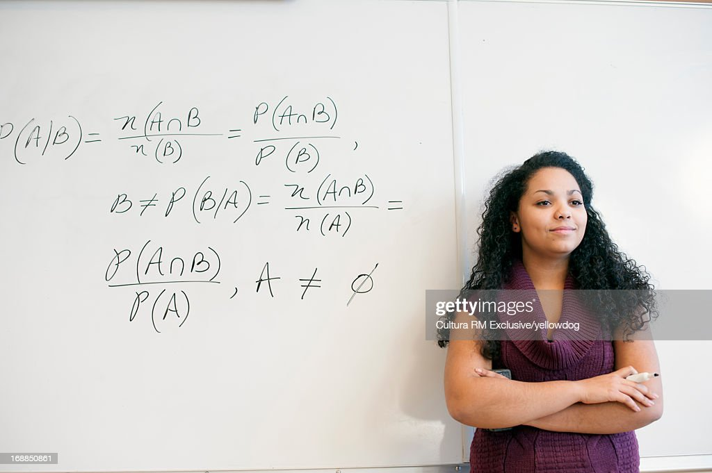 Student at whiteboard in math class : Stock Photo